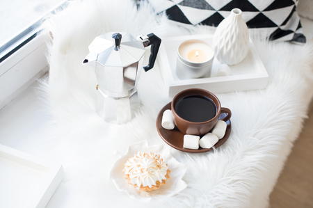 Cozy white winter home arrangement on windowsill, coffee and swe 스톡 콘텐츠 - 115397031