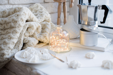 Cozy winter interior styling and decor, warm string lights in bell jar Stockfoto