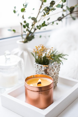 Interior tray decoration with burning candle, mimosa flowers and branches Reklamní fotografie