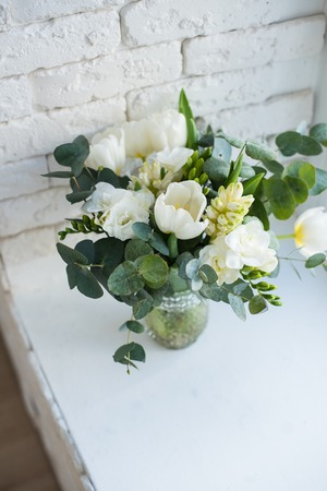Elegant bouquet of white freesias, tulips and hyacinth, beautiful bouquet of flowers Stock Photo