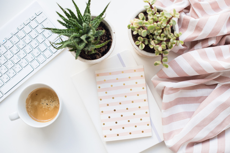 Minimalist ladys flat lay workplace decoration with coffee cup and keypad Stock Photo