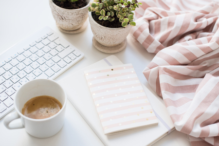 Minimalist ladys flat lay workplace decoration with coffee cup and keypad Фото со стока