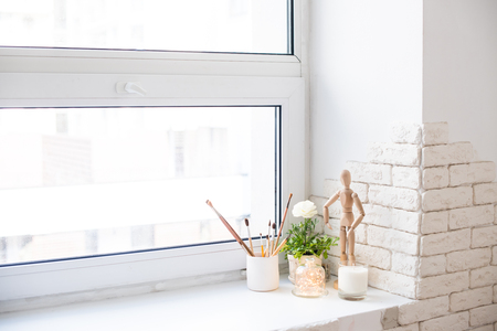 Contemporary home decor with buttercups and candles on windowsill