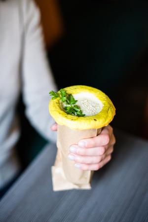Woman holding healthy vegan street food in her hands