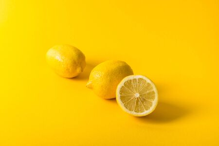 Natural fresh juicy lemons on yellow background Stockfoto