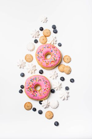 Fresh sweet bonuts on white studio background