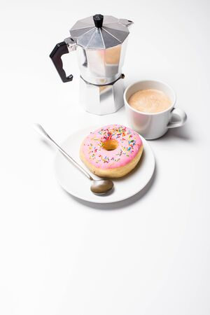 Fresh hot coffe and pink sweet donut on white background isolated