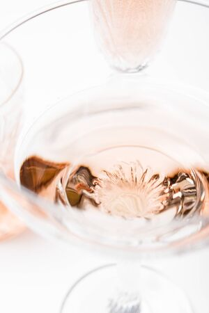 Sparkling rose wine in different glasses on white background Stockfoto