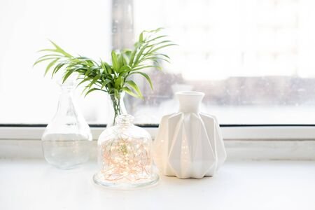 White real home decor, ceramic interior details with vases and candles