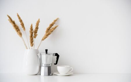 White home decor, coffee maker, ceramic vase and cup on tabletop, contemporary interior decoration