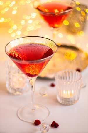 Classic red cocktail in fancy texture glass on bright light bokeh background