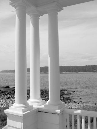 Three Columns next to Sea, in black and white