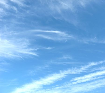 Clouds #2 - Whispy patterns in bold blue sky, with diagonal pattern
