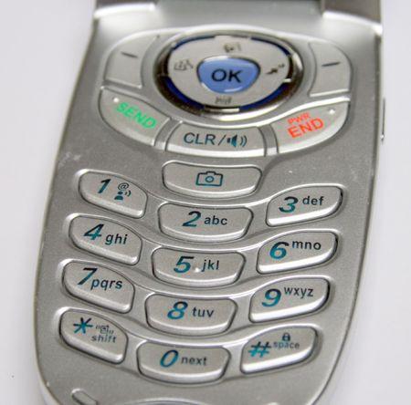 De toetsen van de cel telefoon, zilver geval Stockfoto