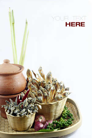 protien: dried fish and other ingredients for tom-yum ( Thai soup ) over white background with sample text