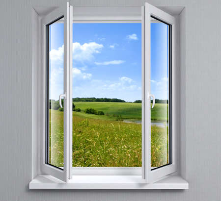 elevated view: Opened plastic window new in room with view to green field Stock Photo