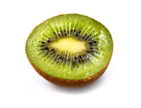 Ripe juicy cut by kiwi on a white background         photo