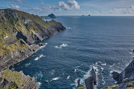 Beautiful coastline at the Ring of Kerry, Ireland. Huge cliffs at the Ring of Kerry Ireland. View on the Skellig Islands, Ireland.