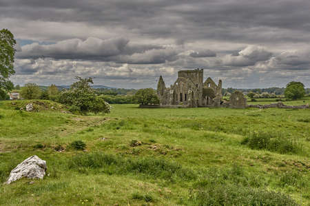 Mystic castle ruin in Ireland. Panoramic view of abandoned castle ruin in Ireland. Old castle ruin in Ireland.