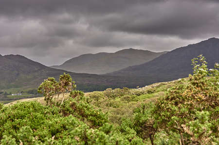 Panoramic view from a mountain in the Connemara National Park, Ireland. Hiking through the mountains in Connemara National Park, Ireland. Reklamní fotografie