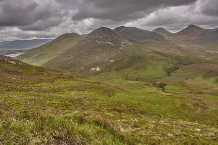 Panoramic view from a mountain in the Connemara National Park, Ireland. Hiking through the mountains in Connemara National Park., Ireland.