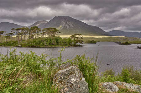 Beautiful mountain lake in Connemara National Park, Ireland. Lonely mountain landscape in Connemara National Park, Ireland.