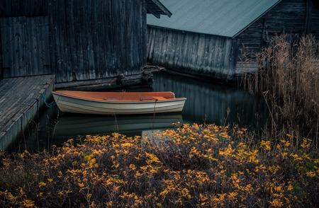 sennen: Boat near the pier in the on the Baltic Sea Aland Islands Stock Photo