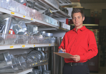 A employee of a hardware store at work. photo