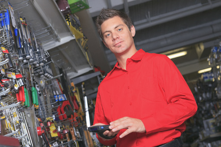 hardware: A employee of a hardware store at work.