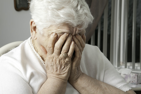upset: portrait of an elderly woman with problem