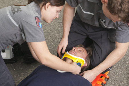 stabilization: Paramedic employee with ambulance in the background.