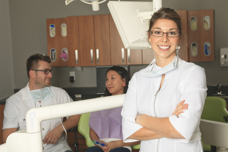 dental office: A dental office with employee and client Stock Photo
