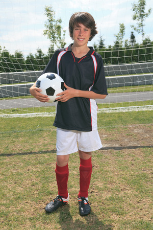 13 year old boy: A soccer player on the play field.