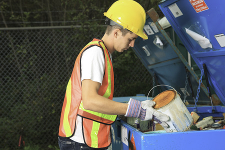 recycling center: A worker who recycling thing on recycle center