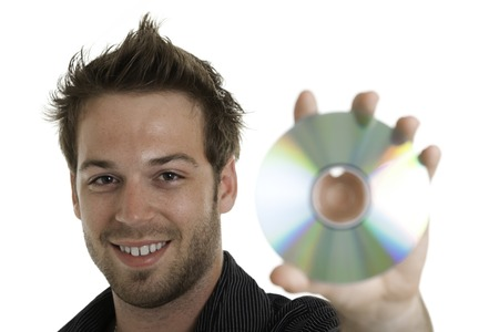 A 30 years old men holding a cd or a dvd photo