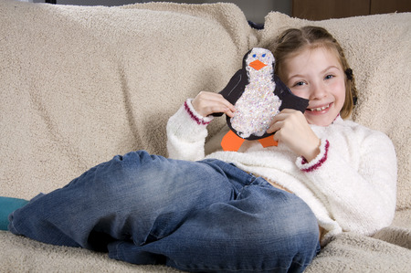 snuggle: A Little girl having fun at home Stock Photo