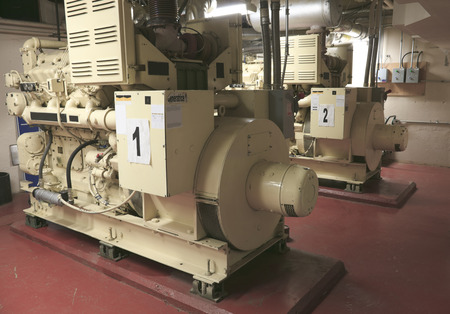 electric power station: Electric Industrial generator inside power plant closeup