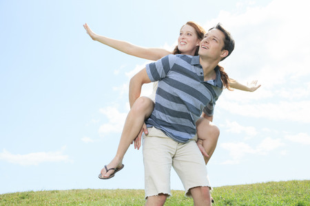 25 to 30 years old: A couple outside having fun together outside Stock Photo