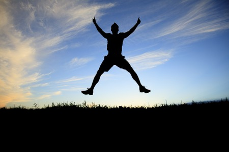 Man jump on the sunset day time. Stock Photo