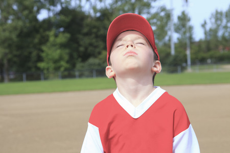 A children baseball player dont want to play photo