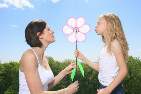 A Mother and Daughter play with the wind