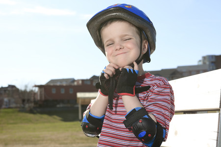 overbalance: Boy having fun, rollerblading outdoor on a sunny summer day