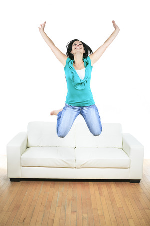 woman on couch: A Beautiful smiling woman relaxing in sofa