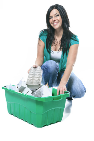 25 30 years women: Young woman recycling wearing with green clothe Stock Photo