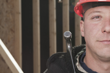 machinerie: carpenter photo - A construction  men working outside Stock Photo