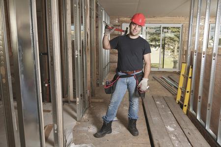 home addition: carpenter photo - A construction men working