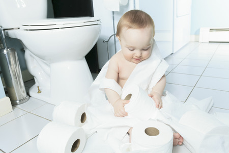 troublemaker: Toddler ripping up toilet paper in bathroom