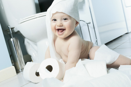 misbehavior: Toddler ripping up toilet paper in bathroom