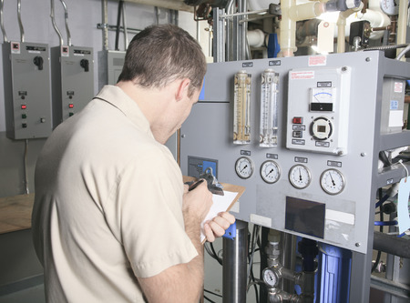 testing: A Air Conditioner Repair Man at work Stock Photo