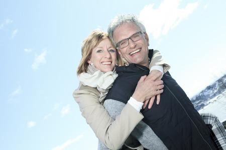 50 to 60 years: Portrait of happy senior couple in winter season
